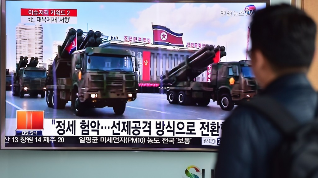 A man watches a news report showing file footage of North Korean missiles on parade, at a railway station in Seoul on March 4, 2016. North Korean leader Kim Jong-Un has ordered its nuclear arsenal readied for pre-emptive use at anytime, in an expected ramping up of rhetoric following the UN Security Council's adoption of tough new sanctions on Pyongyang.    AFP PHOTO / JUNG YEON-JE / AFP / JUNG YEON-JE