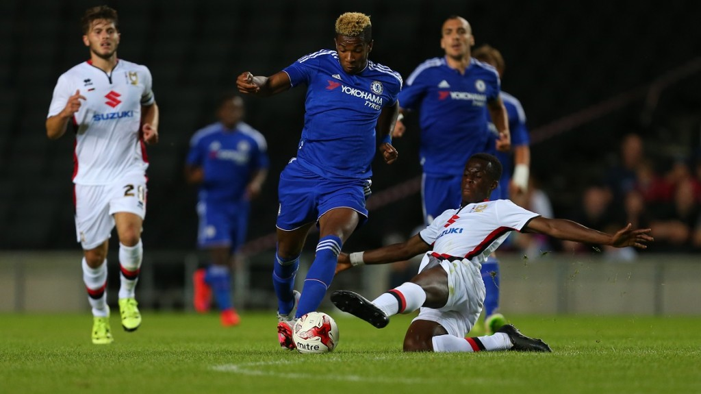 MILTON KEYNES, ENGLAND - AUGUST 03: Kasey Palmer of Chelsea is tackled by Andrew Osei-Bonsu of MK Dons during the pre-season friendly between MK Dons and a Chelsea XI at Stadium mk on August 3, 2015 in Milton Keynes, England.  (Photo by Catherine Ivill - AMA/Getty Images)