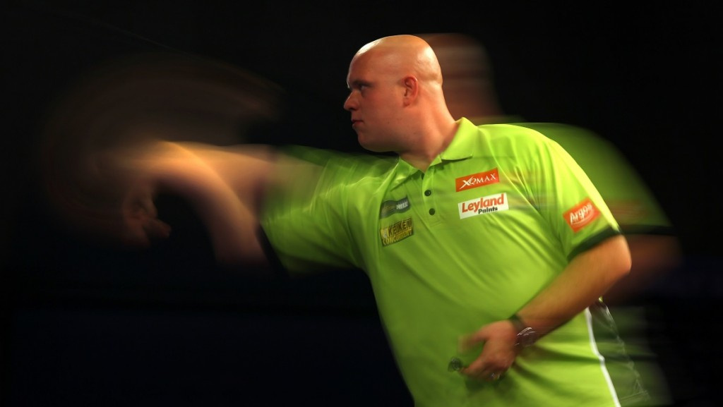 during his first round match against XXX on day two of the 2016 William Hill PDC World Darts Championships at Alexandra Palace on December 18, 2015 in London, England.