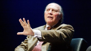 2002 Nobel Prize laureate for Literature Imre Kertesz of Hungary gestures during a discussion with Swedish literary critics at the Stockholm Community Theatre, 09 December 2002. The 2002 Nobel Prize laureates will receve their awards at formal ceremonies in Stockholm and Oslo 10 December.  / AFP / SCANPIX SWEDEN / HENRIK MONTGOMERY