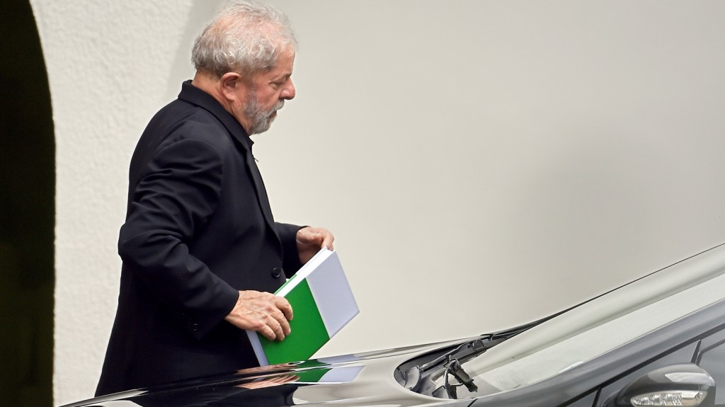 """Former Brazilian President Luiz Inacio Lula da Silva leaves after having a breakfast meeting with senators from several parties at the residence of Senate President Renan Calheiros, in Brasilia, on March 9, 2016. Lula da Silva is facing allegations of taking bribes and laundering money from Petrobras-connected companies. On March 4 he was briefly detained for questioning over alleged """"favours"""" received from corrupt construction companies implicated in a kickback scheme, prosecutors said. Lula da Silva was targeted as part of the Operation Car Wash investigation into a sprawling embezzlement and bribery conspiracy centred on the state oil giant Petrobras.  AFP PHOTO/EVARISTO SA / AFP / EVARISTO SA"""