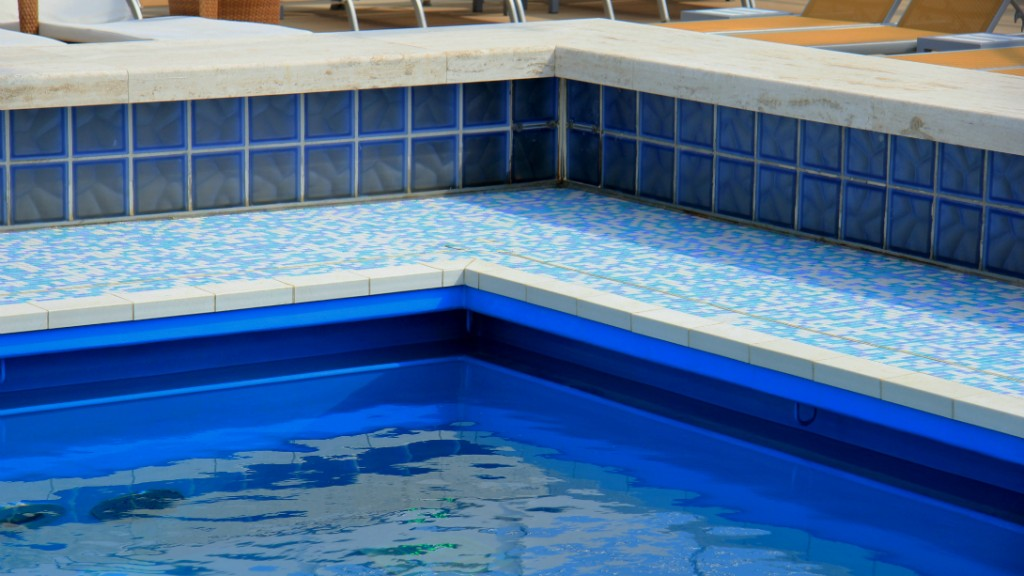 Detail of a simming pool with mosaic tile floor