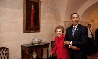 President Barack Obama and former First Lady Nancy Reagan walk side-by-side through Center Hall in the White House, June 2, 2009. To the left of Mrs. Reagan hangs her official White House portrait as First Lady. (Official White House Photo by Pete Souza)This official White House photograph is being made available for publication by news organizations and/or for personal use printing by the subject(s) of the photograph. The photograph may not be manipulated in any way or used in materials, advertisements, products, or promotions that in any way suggest approval or endorsement of the President, the First Family, or the White House.