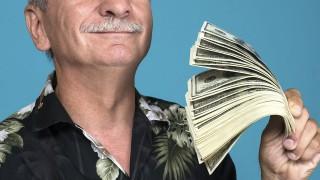 Lucky old man holding dollar bills