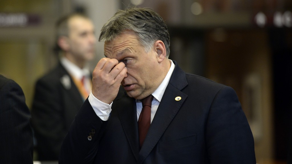 Prime Minister of Hungary Viktor Orban leaves a Special EU Summit on migrants held at the European Union Council building in Brussels on March 08, 2016. European Union leaders will on March 7 back closing down the Balkans route used by most migrants to reach Europe, diplomats said, after at least 25 more people drowned trying to cross the Aegean Sea en route to Greece. The declaration drafted by EU ambassadors on March 6 will be announced at a summit in Brussels on March 7, set to also be attended by Turkish Prime Minister Ahmet Davutoglu. / AFP / THIERRY CHARLIER