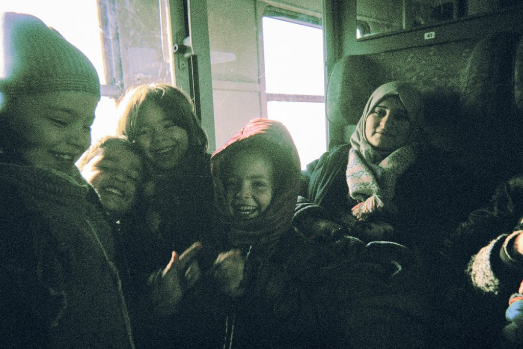 Son Kerim is joking around with other kids in a train compartment on their way to Germany.