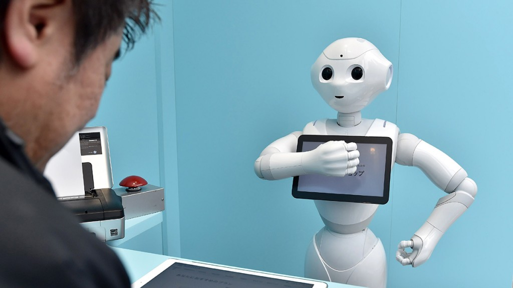 Pepper, a humanoid robot waits on customers at a Softbank smartphone shop  in Minato Ward,  Tokyo on March 24, 2015.  The shop offers alomost entire Pepper staff and the  robots can  give several service like smartphone price and how to use. The shop  is schedluled to open through March 30. ( The Yomiuri Shimbun )