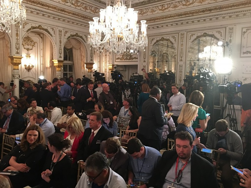 Members of the media await the arrival of Republican presidential candidate Donald Trump for a press conference at the Mar-a-Lago Resort in Palm Beach, Florida.  Millions of Americans cast ballots Tuesday, March 1, 2016 on the most pivotal day of the presidential primary season, with frontrunners Republican Donald Trump and Democrat Hillary Clinton hoping to wipe out all rivals for their party nominations. / AFP / Gaston De Cardenas
