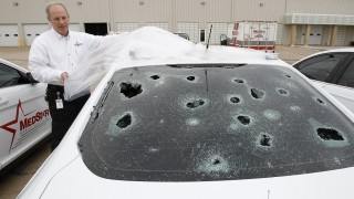 Matt Zavadsky of MedStar, ambulance service, shows hail damage on a response vehicle at their main office on Thursday, March 17, 2016 in Fort Worth, Texas. (Khampha Bouaphanh/Fort Worth Star-Telegram/TNS)