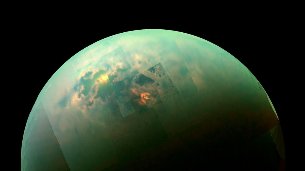"""This NASA image obtained October 31, 2014 shows a near-infrared, color mosaic from NASA's Cassini spacecraft showing the sun glinting off of Titan's north polar seas. While Cassini has captured, separately, views of the polar seas  and the sun glinting off of them  in the past, this is the first time both have been seen together in the same view.The sunglint, also called a specular reflection, is the bright area near the 11 o'clock position at upper left. This mirror-like reflection, known as the specular point, is in the south of Titan's largest sea, Kraken Mare, just north of an island archipelago separating two separate parts of the sea. The view was acquired during Cassini's August 21, 2014, flyby of Titan, also referred to as """"T104"""" by the Cassini team. The view contains real color information, although it is not the natural color the human eye would see. Here, red in the image corresponds to 5.0 microns, green to 2.0 microns, and blue to 1.3 microns. These wavelengths correspond to atmospheric windows through which Titan's surface is visible. The unaided human eye would see nothing but haze. AFP PHOTO/NASA/JPL-Caltech/University of Arizona/U. of Idaho/HANDOUT  =  RESTRICTED TO EDITORIAL USE / MANDATORY CREDIT: """"AFP PHOTO /NASA/JPL-Caltech/University of Arizona/U. of Idaho""""/ NO MARKETING - NO ADVERTISING CAMPAIGNS/ Ė NO A LA CARTE SALES / DISTRIBUTED AS A SERVICE TO CLIENTS /  = / AFP / NASA / Handout"""