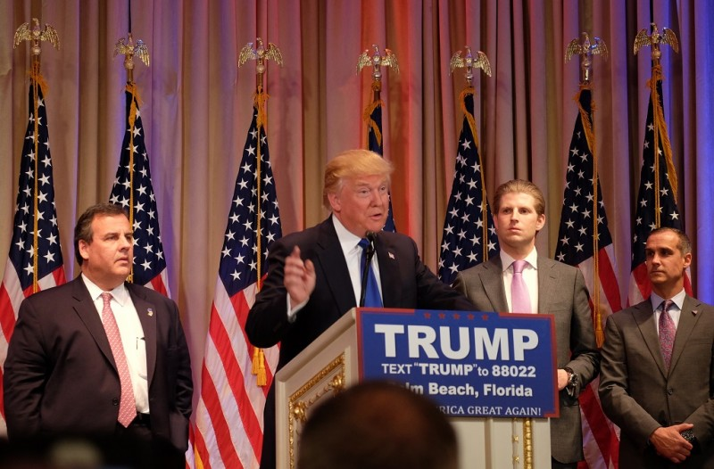 """Republican presidential candidate Donald Trump speaks to the media during a campaign event on March 1, 2016 in Palm Beach, Florida, following """"Super Tuesday"""" poll results. At left is New Jersey Governor and former White House hopeful Chris Christie.    White House hopeful Donald Trump said after a string of wins in the Super Tuesday primaries that he can bring the Republican party together to win the US presidency in November.  / AFP / Gaston De Cardenas"""