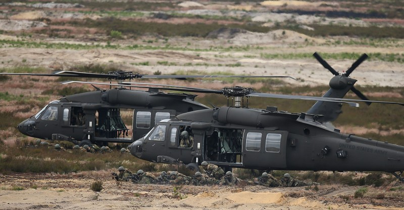 ZAGAN, POLAND - JUNE 18:  Blackhawk helicopters of the U.S. Army ferry Dutch soldiers participating in the NATO Noble Jump military exercises of the VJTF forces on June 18, 2015 in Zagan, Poland. The VJTF, the Very High Readiness Joint Task Force, is NATO's response to Russia's annexation of Crimea and the conflict in eastern Ukraine. Troops from Germany, Holland, Norway, Belgium, Poland, Czech Republic, Lithuania and Belgium were among those taking part today.  (Photo by Sean Gallup/Getty Images)