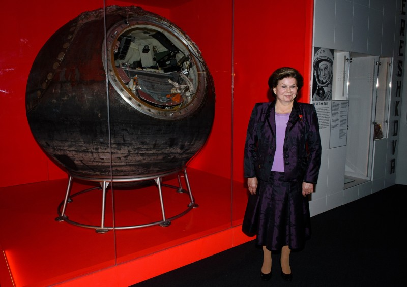 """Soviet cosmonaut, Dr Valentina Tereshkova poses with the Vostok 6 capsule in London on September 17, 2015, at a press preview for the Science Museum's latest exhibition """"Cosmonaut"""". Tereshkova was the first woman in space, piloting Vosotk 6 on June 16, 1963. Her flight lasted 2 days, 22 hours and 50 minutes. The exhibition charts Russia's space programme, from early theories and predictions by artists and scientists through to recent work on the International Space Station. The exhibition is due to run from September 18, 2015 to March 13, 2016.    AFP PHOTO / LEON NEAL / AFP / LEON NEAL"""