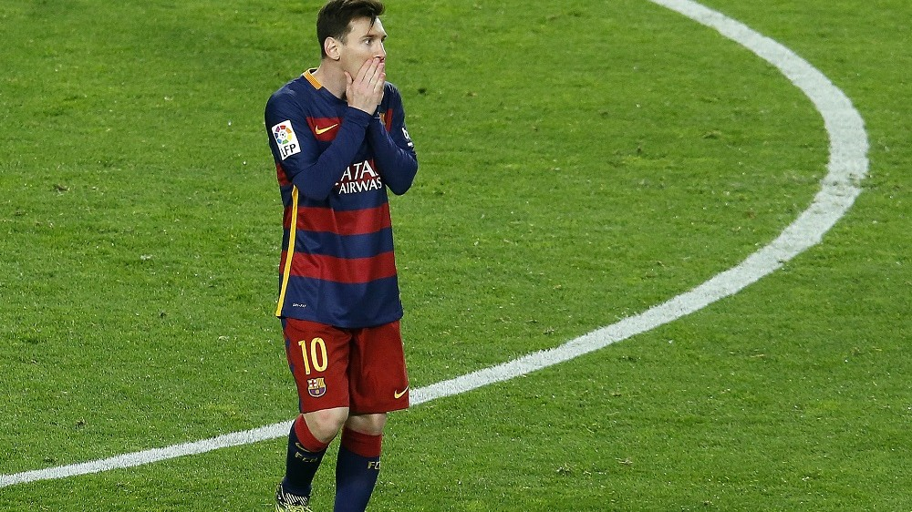 """Barcelona's Argentinian forward Lionel Messi reacts after missing a goal opportunity  during the Spanish league """"Clasico"""" football match FC Barcelona vs Real Madrid CF at the Camp Nou stadium in Barcelona on April 2, 2016. / AFP / PAU BARRENA"""