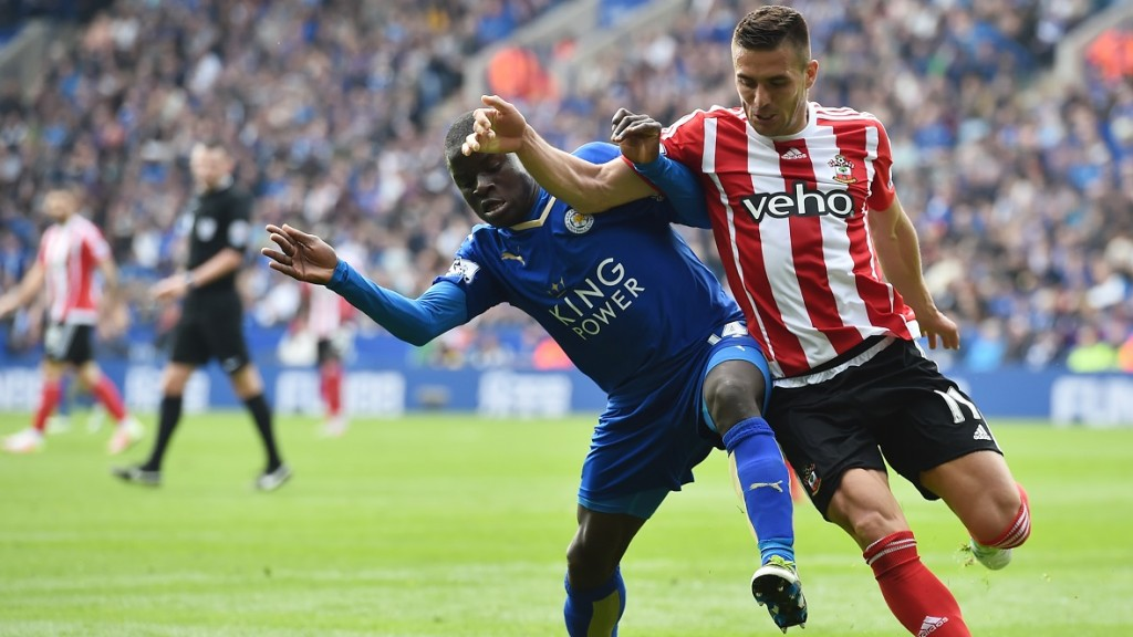 Leicester City's French midfielder N'Golo Kante (L) vies with Southampton's Serbian midfielder Dusan Tadic during the English Premier League football match between Leicester City and Southampton at King Power Stadium in Leicester, central England on April 3, 2016. / AFP / BEN STANSALL / RESTRICTED TO EDITORIAL USE. No use with unauthorized audio, video, data, fixture lists, club/league logos or 'live' services. Online in-match use limited to 75 images, no video emulation. No use in betting, games or single club/league/player publications.  /