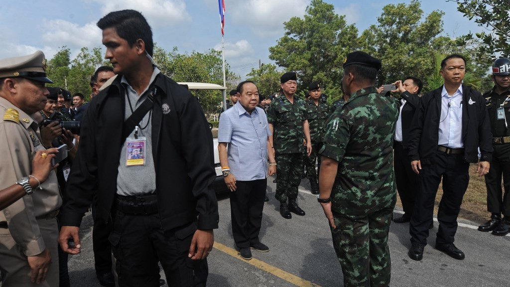 Deputy Thai Prime Minister Prawit Wongsuwon (C) is greeted by military officials before meeting a group of some 650 Muslim people - 'returnees' to Thailand's unrest-hit deep South under a 'Bring people home' scheme - in Thailand's southern province of Narathiwat on April 6, 2016.   The initiative allows wanted men to return to their villages if they renounce any ties with the rebel movement. While suspected insurgents are on the Thai state wanted lists, rights groups say hundreds of other men have been falsely flagged as having links to the rebellion – sometimes through family or loose ties with known insurgents. Many have fled the deep south fearing arrest or even extra-judicial punishment, where more than 6,500 people -- the majority civilians -- have died since an Islamist rebellion against Thai rule re-ignited in 2004. / AFP PHOTO / MADAREE TOHLALA