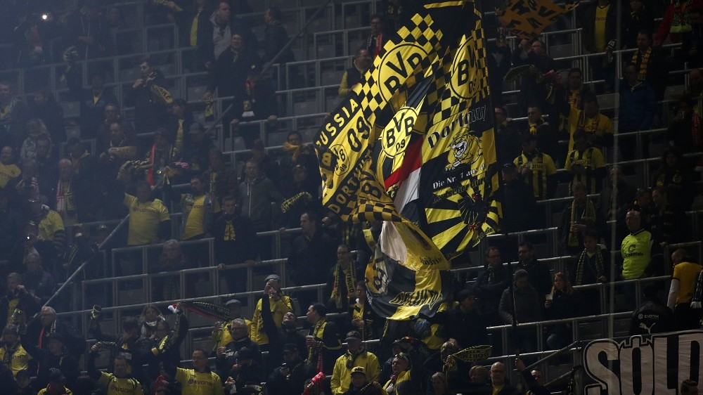 Dortmund fans wave their flags prior to the UEFA Europe League quarter-final, first-leg football match Borussia Dortmund vs Liverpool FC in Dortmund, western Germany on April 7, 2016. / AFP PHOTO / ODD ANDERSEN