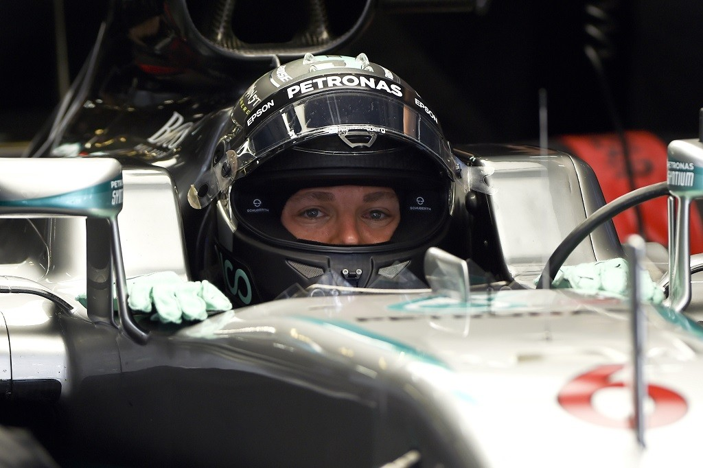Mercedes AMG Petronas F1 Team's German driver Nico Rosberg sits in his car during the first practice session for the Formula One Chinese Grand Prix in Shanghai on April 15, 2016. / AFP PHOTO / WANG ZHAO