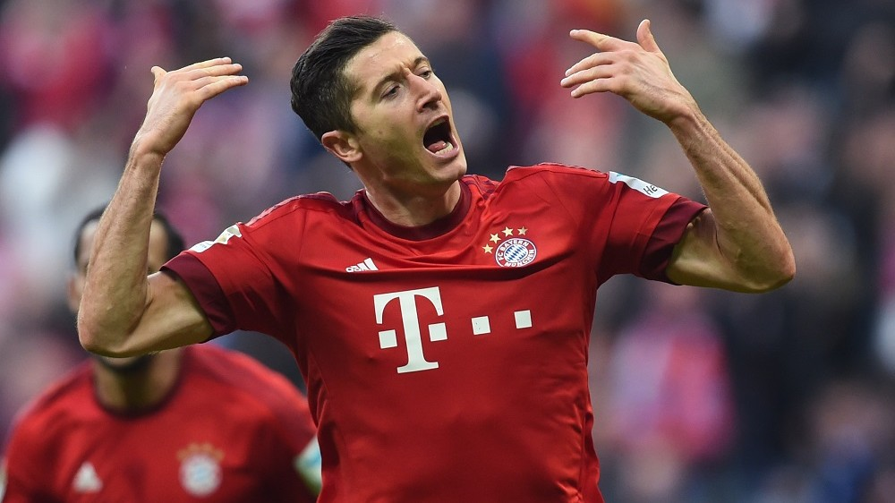 Bayern Munich's Polish striker Robert Lewandowski celebrates scoring during the German first division Bundesliga football match FC Bayern Munich vs Schalke 04 in Munich, southern Germany, on April 16, 2016. / AFP PHOTO / CHRISTOF STACHE / RESTRICTIONS: DURING MATCH TIME: DFL RULES TO LIMIT THE ONLINE USAGE TO 15 PICTURES PER MATCH AND FORBID IMAGE SEQUENCES TO SIMULATE VIDEO. == RESTRICTED TO EDITORIAL USE == FOR FURTHER QUERIES PLEASE CONTACT DFL DIRECTLY AT + 49 69 650050