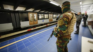 A Belgian serviceman stands guard as a train arrives at the Maelbeek - Maalbeek metro station on its re-opening day on April 25, 2016 in Brussels, after being closed since the 22 March attacks in the Belgian capital.  Maelbeek - Maalbeek metro station was hit by one of the three Islamic State suicide bombers who struck Brussels airport and metro on March 22, killing 32 people and injuring hundreds. / AFP PHOTO / BELGA / THIERRY ROGE
