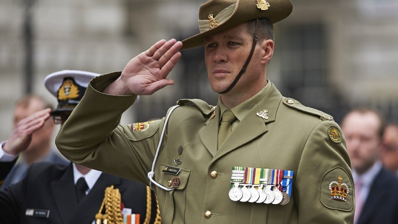 An Australian serviceman salutes during a service to commemorate Anzac Day at the Cenotaph on Whitehall in central London on April 25, 2016. Anzac Day marks the anniversary of the first major military action fought by Australian and New Zealand forces during the First World War. The Australian and New Zealand Army Corps (ANZAC) landed at Gallipoli in Turkey during World War I. / AFP PHOTO / NIKLAS HALLE'N