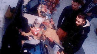 (FILES) This file video image taken from a CCTV camera at a petrol station in Ressons, North of Paris, on November 11, 2015 shows Salah Abdeslam (R), a suspect in the Paris attack of November 13, and Mohamed Abrini (C) buying goods. Top Paris attacks suspect Salah Abdeslam was handed over to French authorities on April 27, 2016, federal prosecutors in Belgium said. A French national of Moroccan origin who grew up in Belgium, he is believed to be the last surviving member of the terror squad that killed 130 people in the French capital on November 13, 2015.  / AFP PHOTO / OFF / -