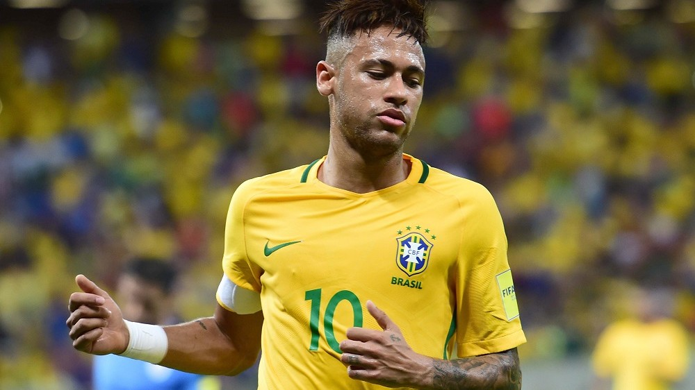Brazil's Neymar gestures during the Russia 2018 FIFA World Cup South American Qualifiers' football match against Uruguay, in Recife, northeastern Brazil, on March 25, 2016.   AFP PHOTO / CHRISTOPHE SIMON / AFP PHOTO / CHRISTOPHE SIMON