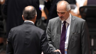 Russian Foreign Minister Sergei Lavrov and  Syria's Ambassador to the UN Bashar Ja'afari(R) at a UN Security Council meeting on settlement of conflicts in the Middle East and North Africa and countering the terrorist threat in the region, during the 70th session of the UN General Assembly September 30, 2015  in New York.    AFP PHOTO / TIMOTHY A. CLARY / AFP PHOTO / TIMOTHY A. CLARY