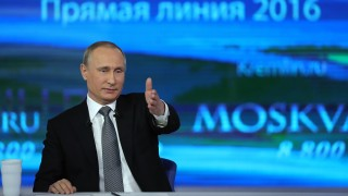 2824486 04/14/2016 April 14, 2016. Russian President Vladimir Putin answers questions during the annual Direct Line with Vladimir Putin broadcast live by Russian TV channels and radio stations. The event takes place in the main studio of the Gostiny Dvor exhibition center, Moscow./Sputnik