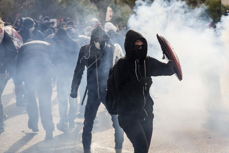 FRANCE, Paris : Participants clash with French anti-riot police during a demonstration against the government's proposed labour reforms in Paris on April 28, 2016. Protesters clashed with police in Paris and western France on April 28 as workers and students across the country made a new push for the withdrawal of a hotly contested labour bill. Demonstrations as well as work stoppages, notably in the aviation and public transport sectors, are planned across France in the latest actions in a protest wave that began two months ago.  - François Plaza