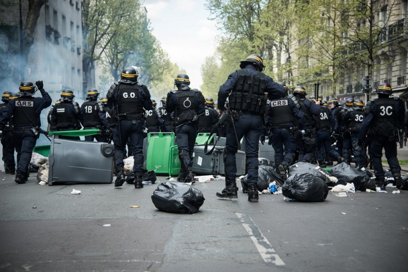 FRANCE, Paris : Participants clash with French anti-riot police during a demonstration against the government's proposed labour reforms in Paris on April 28, 2016. Protesters clashed with police in Paris and western France on April 28 as workers and students across the country made a new push for the withdrawal of a hotly contested labour bill. Demonstrations as well as work stoppages, notably in the aviation and public transport sectors, are planned across France in the latest actions in a protest wave that began two months ago. - Mannone CADORET