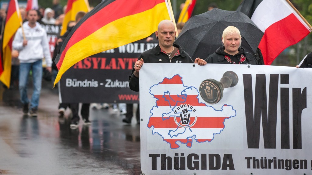 Protesters of the anti-Islam groupThuegida carry placards as they march toward the local refugee reception facility during a rally inSuhl, Germany, 17 August 2015. The Higher Administrative Court in Weimar had approved the right-wing demonstration subject to certain requirements. As a result, the rally had to be held further away from the refugee reception facility in Suhl than planned. Photo: Michael Reichel/dpa