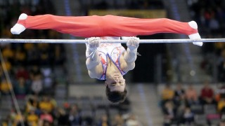 Russia's Nikolai Kuksenkov in action on the high bar during the men's final at the gymnastics DTB Cup World Cup in Stuttgart, Germany, 20 March 2016. Photo:RONALDWITTEK/dpa