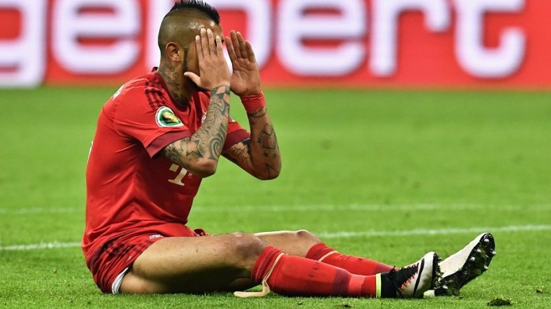 Munich's Arturo Vidal sits on the ground during the GermanDFBCup semi final soccer match between Bayern Munich and Werder Bremen at the Allianz Arena inMunich,Germany, 19 April 2016. Photo: PETERKNEFFEL/dpa