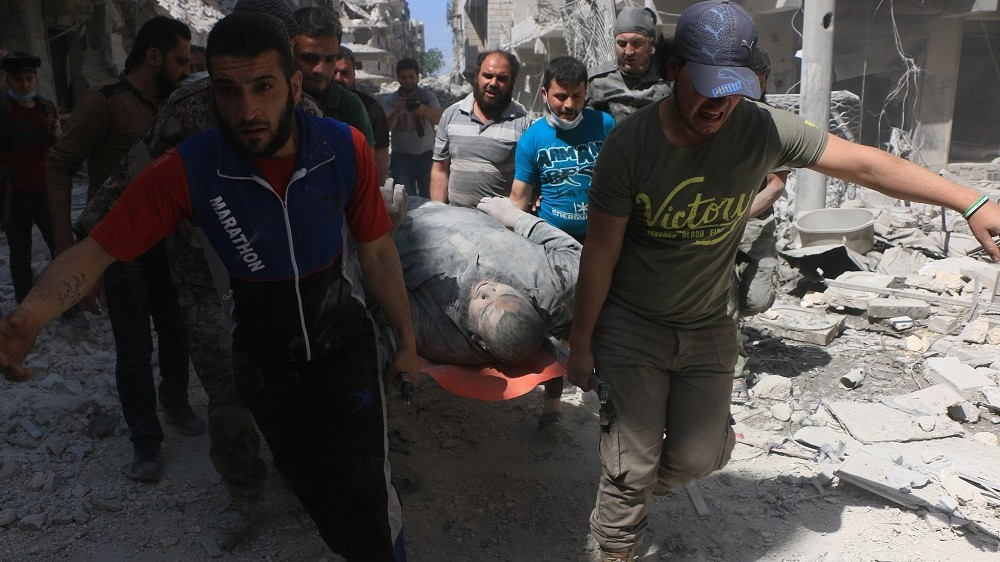 ALEPPO, SYRIA - APRIL 28: (EDITORS NOTE: Image contains graphic content.) A wounded man is taken to hospital by health workers after the war crafts belonging to the Russian army carried out airstrikes on the residential areas in the Sukkeri neighborhood of Aleppo, Syria on April 28, 2016.    Beha el halebi / Anadolu Agency