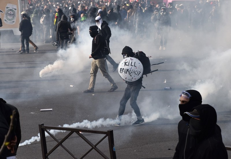 PARIS, FRANCE - APRIL 28: Protestors clash with French anti-riot police during a protest against the French government's proposed labour reforms at the Place de la Nation in Paris, France on April 28, 2016. Protesters clashed with police in Paris and western France on April 28 as workers and students across the country made a new push for the withdrawal of a hotly contested labour bill. Mustafa Yalcin / Anadolu Agency