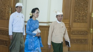 NAYPYITAW, MYANMAR - MARCH 30 :  Myanmar's new Foreign minister Aung San Suu Kyi arrives to attend the ceremony to handover the country's presidency to new President Htin Kyaw at the presidential palace in Naypyitaw, Myanmar, 30 March 2016.  Aung Naing Soe / Anadolu Agency
