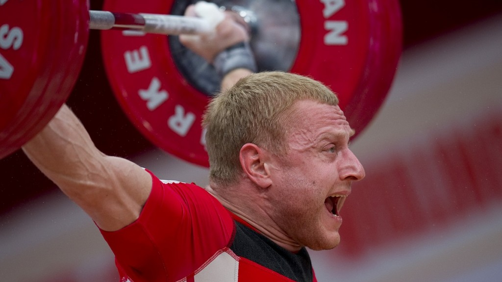 WROCLAW, POLAND - OCTOBER 25: Andrei Rybakov from Belarus lifts in the Snatch competition men's 85 kg mGroup A during weightlifting IWF World Championships Wroclaw 2013 at Centennial Hall in Wroclaw on October 25, 2013 (Photo by Adam Nurkiewicz/Getty Images)
