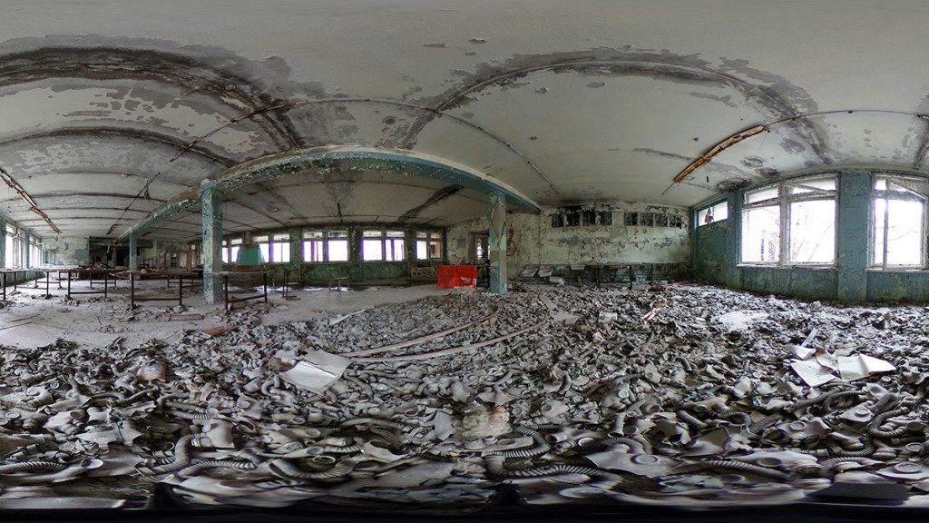 PRIPYAT, UKRAINE - APRIL 09:  (EDITOR'S NOTE: Image was created as an Equirectangular Panorama. Import image into a panoramic player to create an interactive 360 degree view.) Gas masks lie scattered on the floor of a former classroom in elementary school number three on April 9, 2016 in Pripyat, Ukraine. Pripyat, built in the 1970s as a model Soviet city to house the workers and families of the Chernobyl nuclear power plant, now stands abandoned inside the Chernobyl Exclusion Zone, a restricted zone contaminated by radiation from the 1986 meltdown of reactor number four at the nearby Chernobyl plant in the world's worst civilian nuclear accident that spewed radiaoactive fallout across the globe. Authorities evacuated approximately 43,000 people from Pripyat in the days following the disaster and the city, with its high-rise apartment buildings, hospital, shops, schools, restaurants, cultural center and sports facilities, has remained a ghost-town ever since. The world will soon commemorate the 30th anniversary of the April 26, 1986 Chernobyl disaster.  (Photo by Sean Gallup/Getty Images)