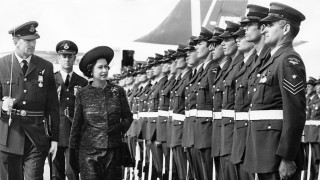 Queen Elizabeth II inspects a Royal New Zealand Air Force (RNZAF) Guard of Honour at Auckland Airport, during her tour of New Zealand, March 1970. She is accompanied by the Guard Commander, Flight Lieutenant M. W. D. Robinson. She is there in connection with the bicentenary of Captain Cook's 1770 expedition to Australia. (Photo by Central Press/Hulton Archive/Getty Images)