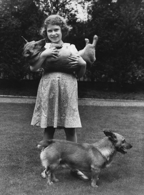 Princess Elizabeth (now Queen Elizabeth II) with two corgi dogs at her home at 145 Piccadilly, London, July 1936. (Photo by Lisa Sheridan/Studio Lisa/Hulton Archive/Getty Images)