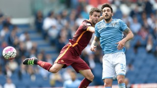 ROME, ITALY - APRIL 03: Miralem Pjanic (L) of AS Roma in action against Danilo Cataldi (R) of SS Lazio during the Serie A match between SS Lazio and AS Roma at Stadio Olimpico on April 3, 2016 in Rome, Italy.  Claudio Pasquazi  / Anadolu Agency