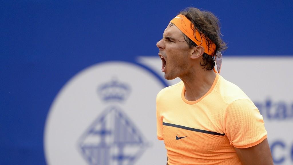 "Spain's player Rafael Nadal celebrates after winning against Italian player Fabio Fognini during the ATP Barcelona Open ""Conde de Godo"" tennis tournament in Barcelona on April 22, 2016.  Nadal won 6-2, 7-6. / AFP PHOTO / JOSEP LAGO"