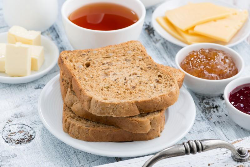Breakfast with toast, jam and black tea