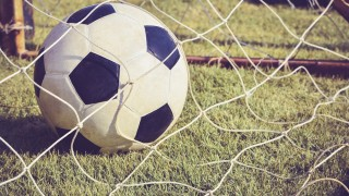 Soccer ball in goal, Close up image