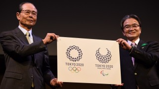 Ryohei Miyata, Tokyo 2020 emblems selection committee chairperson (R) and committee member and former baseball star Sadaharu Oh (L) present the newly-selected Tokyo 2020 logo during an unveiling ceremony in Tokyo on April 25, 2016. Tokyo 2020 Olympic organisers on April 25 announced a new logo more than six months after the original choice was scrapped over an embarrassing plagiarism scandal. / AFP PHOTO / TOSHIFUMI KITAMURA