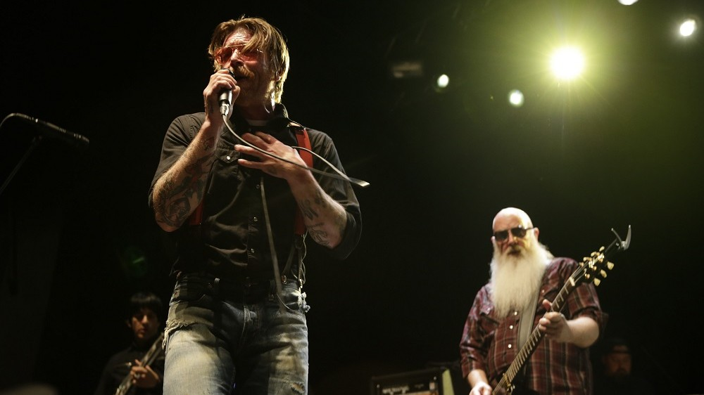 Singer and guitarist of US rock band Eagles of Death Metal, Jesse Hugues, performs on stage at the Sentrum Scene concert hall in Oslo on February 14, 2016. / AFP PHOTO / NTB Scanpix / BERIT ROALD / Norway OUT