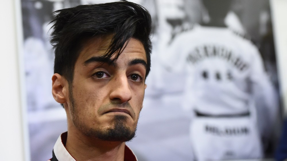 """Belgian Taekwondo athlete Mourad Laachraoui, younger brother of Brussels attacks suspect Najim Laachraoui, gives a press conference on March 24, 2016, at the headquarters of the Francophone Belgian Taekwondo Association in Ukkel/ Uccle, Brussels, two days after a triple bomb attack, claimed by the Islamic State group, hit Brussels' airport and the Maelbeek - Maalbeek metro station, killing 31 people and wounding 270 others.  Mourad Laachraoui """"firmly"""" condemned his brothers actions saying there had been no contact between the pair since his older brother left Belgium for Syria more than two years ago. / AFP PHOTO / EMMANUEL DUNAND"""