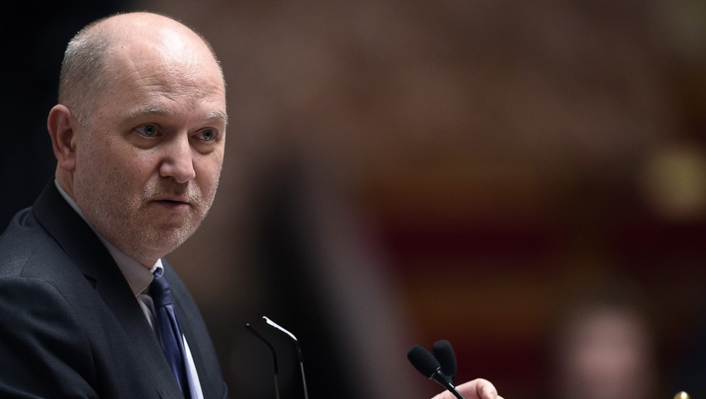 (FILES) This file photo taken on December 2, 2015 shows French National Assembly vice-president Denis Baupin attending a session of questions to the Government at the French National Assembly in Paris. Denis Baupin left the Europe Ecology – The Greens (EELV) party on April 18, 2016. / AFP PHOTO / MARTIN BUREAU