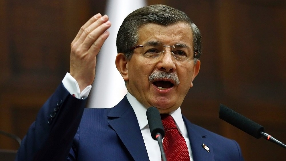 Turkish Prime Minister and leader of Turkey's ruling party, the Justice and Development Party (AKP) Ahmet Davutoglu gives a speech during an AKP meeting at the Grand National Assembly of Turkey (TBMM) in Ankara, on May 03, 2016.   / AFP PHOTO / ADEM ALTAN